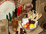 The candles, cup, basket and mat are all used in Kwanzaa ceremonies.
