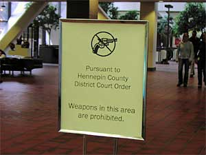 This sign banning guns in the county building is virtually the only sign of security in the center. (MPR Photo/Elizabeth Stawicki)