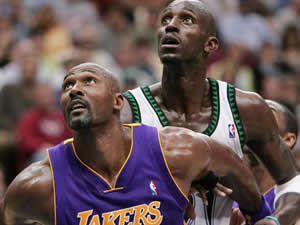 Karl Malone  of the Los Angeles Lakers and Kevin Garnett  of the Minnesota Timberwolves battle for position in the second half of Game one of the Western Conference Finals during the 2004 NBA Playoffs Friday night at the Target Center in Minneapolis.   (Photo by Jed Jacobsohn/Getty Images)