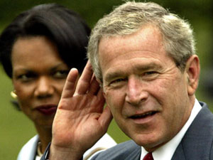 President George W. Bush  holds his hand to his ear beside  National Security Advisor Condoleezza Rice as reporters shout questions over noise from the Marine One helicopter on the South Lawn of the White House on Monday. Bush was about to take the short flight to Andrews Air Force Base in neighboring Maryland state en route to Oak Ridge, Tennessee.   (PAUL J.RICHARDS/AFP/Getty Images)