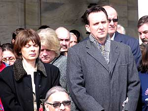 Sen. Sandy Pappas, DFL-St. Paul, and Gov. Tim Pawlenty attend a traditional prayer service at the Capitol to mourn those who died in Red Lake. (MPR Photo/Laura McCallum)