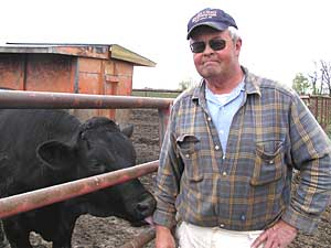 Northfield farmer Ray Larson wants the animal ID system because he thinks it will make consumers more confident about the safety of the food supply.  (MPR Photo/Lorna Benson)