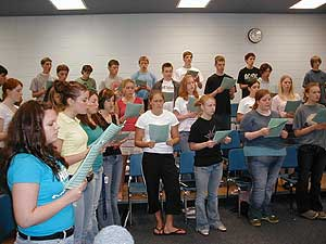 Red Wing High School was one of three selected to participate in the composer in residence program sponsored by VocalEssence.  As a result noted Minnesota composer Cary John Franklin has spent three years working with the group.   (MPR Photo/Erin Galbally)