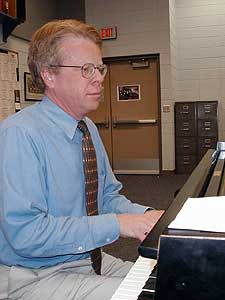 Composer Cary John Franklin spent the past three years working with high school choirs.  He wrote a piece specifically for the Red Wing choir entitled Wild Geese.  That piece and his new rendition of Gloria will be performed at Orchestra Hall in Minneapolis. (MPR Photo/Erin Galbally)