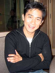Tony Leung has made dozens of films during his career. He says he enjoys working with director Wong Kar Wai because of the way he tells stories. (MPR photo/Euan Kerr)