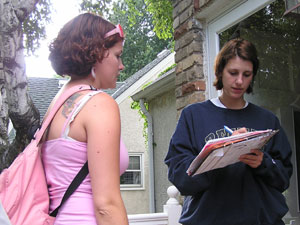 NARAL canvasser Rose Coleman talks to Dana Kelly Breuer near Como Park.  (MPR Photo/Laura McCallum)